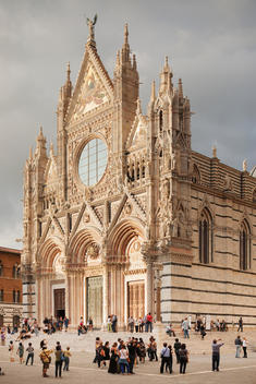 People outside ornate cathedral, Siena, Tuscany, Italy