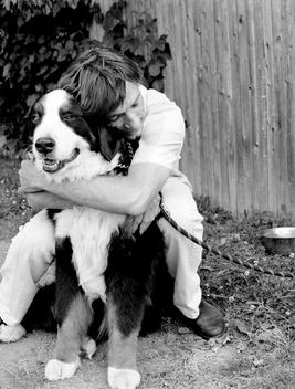 A Man Hugging His Dog.