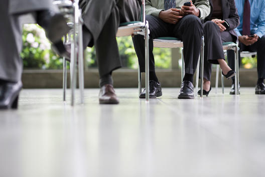 Business people sitting in chairs together