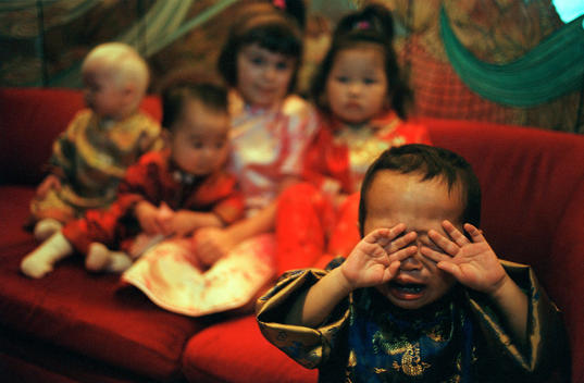A Group Of Children Pose For A Group Photograph Dressed In Traditional Chinese Clothing At A Hotel In Guangzhou, China.
