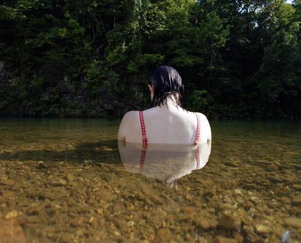 Woman Relaxing In Calm River