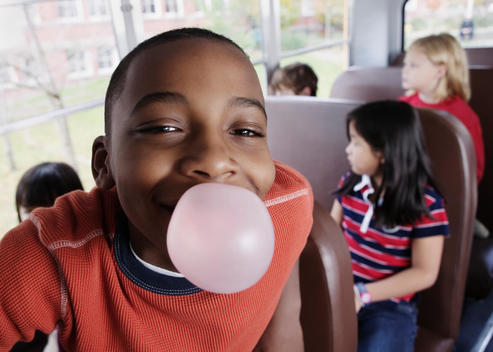 Close up portrait of boy blowing bubble