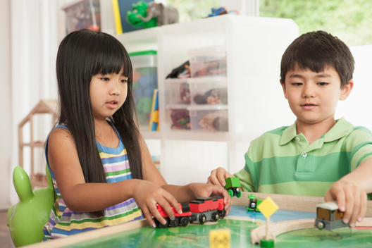 Children playing with train set