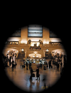 View through camera of two men meeting at Grand Central Station, New York, USA.