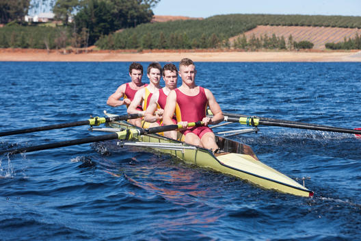 Coxless four rowing boat in water