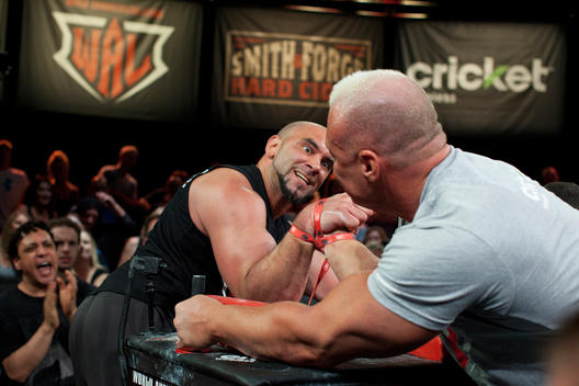 Competitors at the arm wrestling competition in Las Vegas strain as the face off against each other