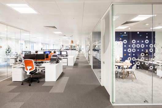 Open plan office area at Informa Office designed by Ben Adams Architects, London, UK.