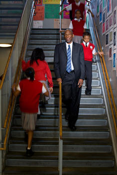 Geoffrey Canada Of Harlem Children\'S Zone Surrounded By School Children On Stairs