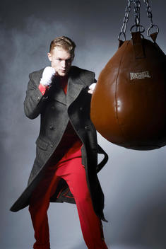 Male model in athletic poses wearing high fashion outfit