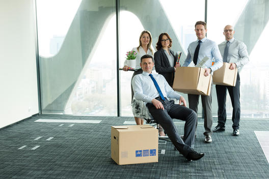 Businesspeople moving into new office