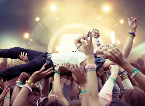 Performer crowd surfing at music festival