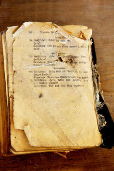 old torn protestant prayer book with text for funeral ceremony