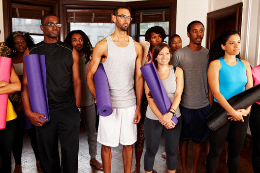 People holding yoga mats