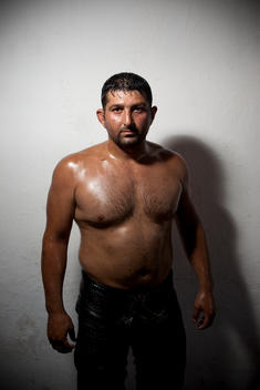 Portrait Of Wrestler In Kirkpinar, A Turkish Oil-Wrestling Tournament. It Is Held Annually, Usually Beginning Of July, Near Edirne, Turkey Since 1346. Before Each Bout, The Wrestlers Pour Olive Oil Over Their Entire Bodies, And The Matches Take Place In A