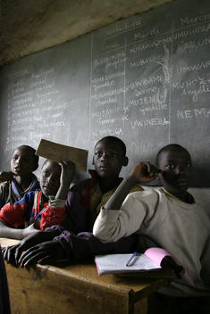 Young students at a school in Rwanda, East Africa. African children studying. African school. Attentive students. 10th anniversary of the Rwandan Genocide, April 2004. Part of their education includes \'civil liberties\' classes where they learn about recon