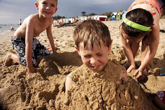Children digging in the sand
