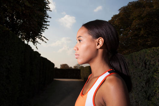Athletic African woman in Jardin des Tuileres, portrait