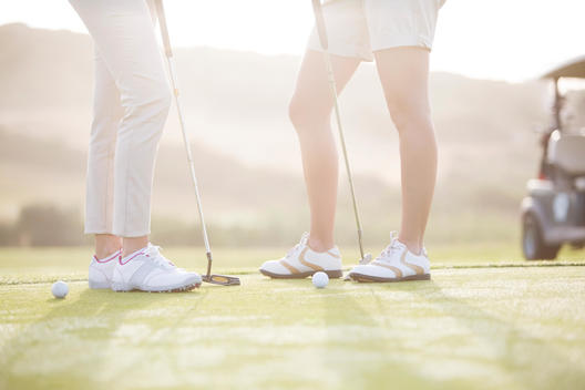 Women standing on golf course