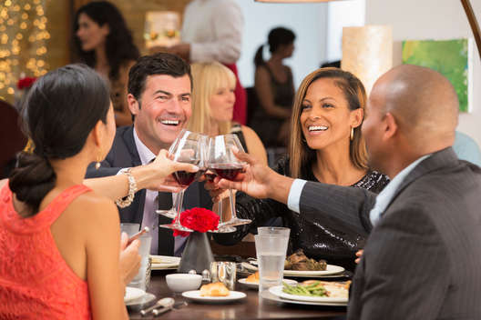 Business people toasting at dinner
