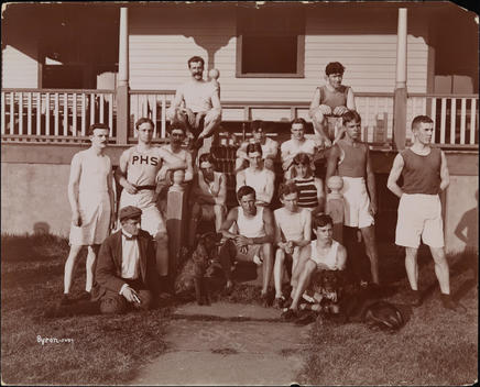 Group Portrait Of The Track And Field Team, Bayonne Athletic Club, Standing And Seated On The Porch Of A Building.