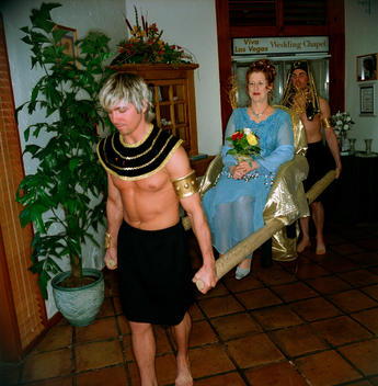Woman Has An Egyptian Themed Wedding And Is Carried Into The Chapel By Two Porters In Fancy Dress At The Viva Las Vegas Wedding Chapel In Las Vegas On Valentines Day.