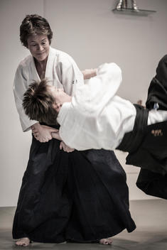 Caucasian people practicing martial arts