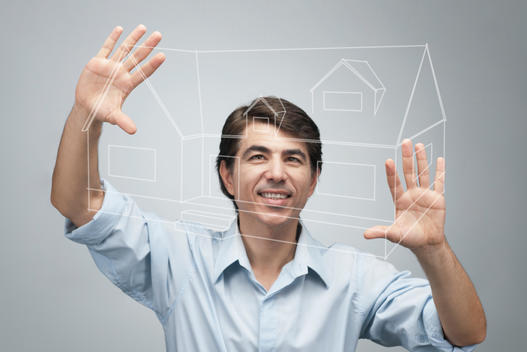 Man using advanced touch screen technology to view house plan