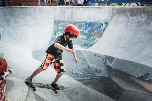 Caucasian boy riding skateboard in skate park