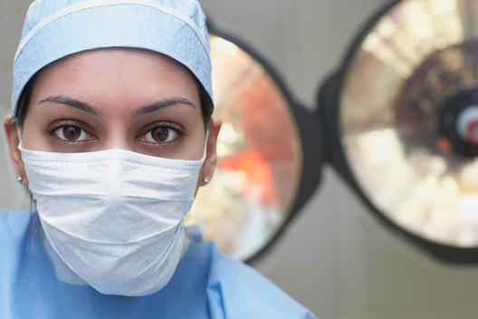 Asian female medical professional wearing surgical mask