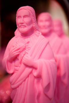 Row Of Pink Jesus Figurines