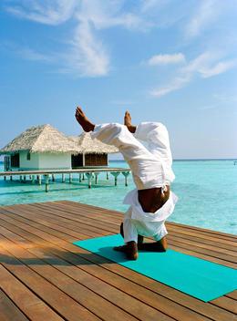 Man Doing Yoga On Beach