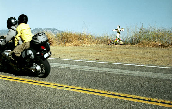 Motorcycle Passing A Roadside Memorial On Mulholland Drive