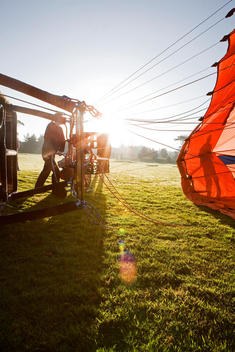 Sunrise Image Of A Hot Air Balloon Being Inflated.