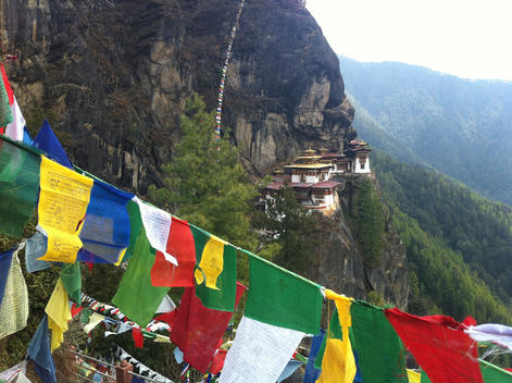 View on tigers nest temple with prayer flags in front, Paro, Bhutan