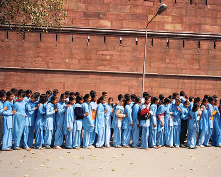 School children in blue uniforms standing in line