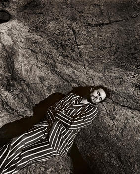 Man Lying On His Back, Striped Suit