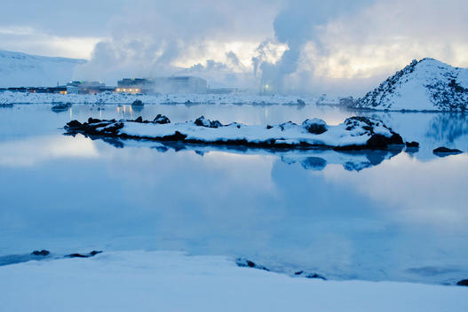 Iceland, Reykjanes Peninsula, Blue Lagoon geothermal spa, geothermal power plant in background