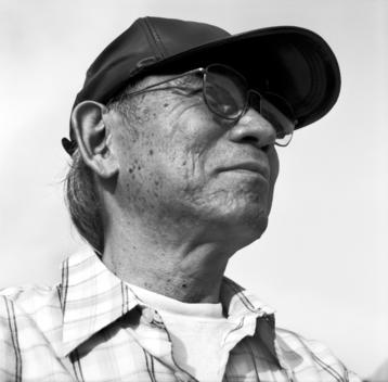 Portrait Of A Senior Man Wearing A Hat.