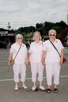 Senior Sisters Dressed In Matching Outfits On Tourist Trip