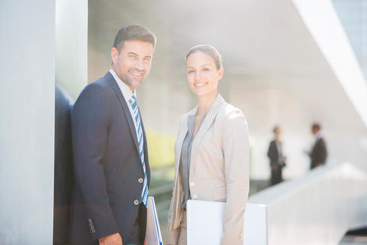 Portrait of confident business people outdoors