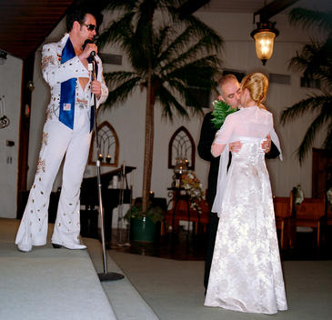 A Couple Kiss After Having Been Married By Elvis Lookalike At The Viva Las Vegas Wedding Chapel In Las Vegas On Valentines Day.