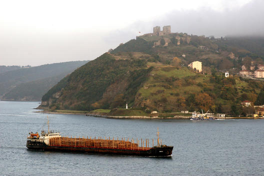 Barge Passing Through The Bosphorus Strait With View Of Yoros Castle On The Hill, Istanbul, Turkey.