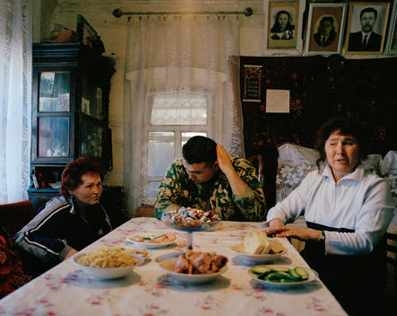 A Russian Family At Their Dinner Table, Recounting The Story Of How A Family Member Died As A Result Of A Nuclear Accident In The Town In 1957.