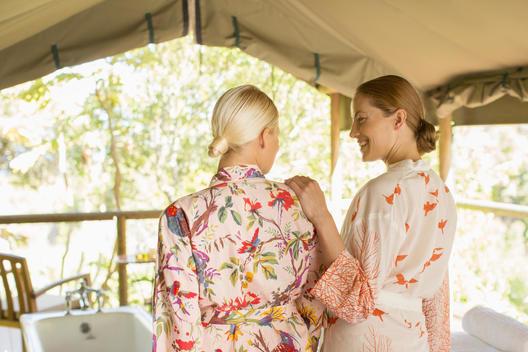 Women wearing bathrobes in spa