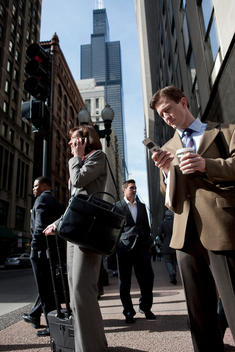 Business People Wait At A Busy Chicago Street Corner.