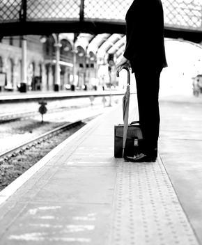 Dapper Businessman Waiting On A Train Platform.
