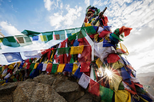 Low angle view of colorful prayer flags on monastery wall