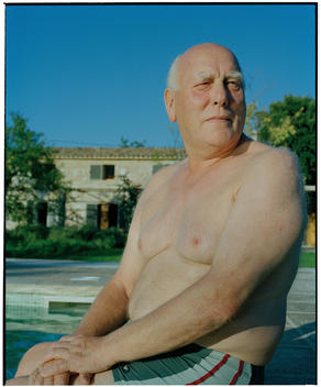 Overweight Senior Man Of Caucasian Appearance Sitting By Pool