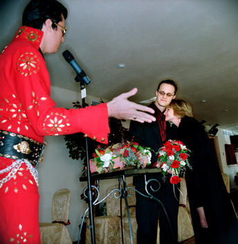 Man Embraces His New Wife As An Elvis Lookalike Sings \