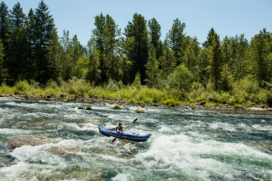Inflatable Kayak on clear water river
